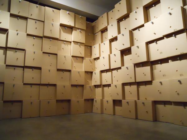 """Zimoun, """"294 prepared dc-motors, cork balls, cardboard boxes 41x41x41cm"""""""