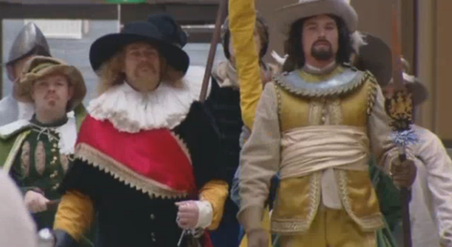 Reenactors in the mall (Screencapture by Hyperallergic from The Guardian)