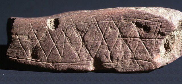 Engraved ochre from Blombos Cave. (image via the National Science Foundationa and courtesy of Chris Henshilwood)