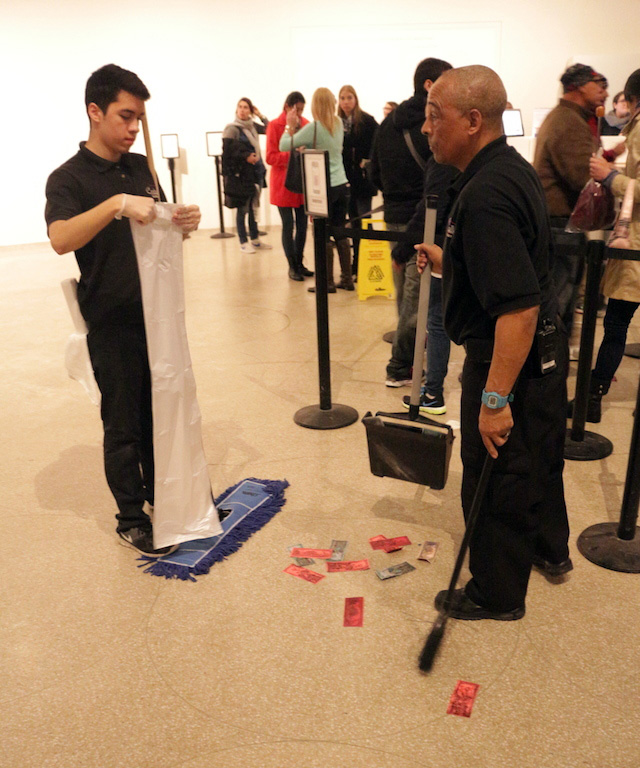 Cleaning staffers collect bills on main floor