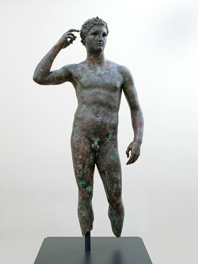 """This sculpture by an unknown artist, """"Victorious Youth"""" (300–100 BCE), bronze with inlaid copper, 59 5/8 x 27 9/16 x 11 in (151.5 x 70 x 27.9 cm), currently on view at the Getty Villa Malibu, is the subject of a current repatriation claim by Greece (The J. Paul Getty Museum, Villa Collection, Malibu, California)"""