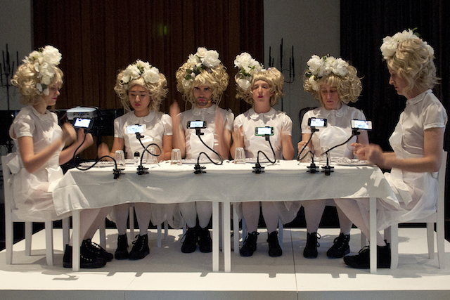 """Claudia Hart, """"The Alices"""" (2013). Claudia Hart with score by Edmund Campion and featuring Mikey McParlane; The Alices (from left): Amanda  Vanvalkenberg, Yaloopop, Mikey McParlane, Christine Shallenberg, Jane Jerardi, Natlalia Nicole Nicholson; dresses and headpieces  by Vincent Tiley. Produced by Ellen Sandor at the Arts Club of Chicago, June 18, 2013. Nue Morte augmented reality dishes,  2012 by Claudia Hart with augmented design by Geoffrey Alan Rhodes, produced by Michele Thursz / SEEK Art."""