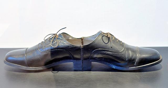"Ai Weiwei, ""One Man Shoe"" (1987), wood board, leather, shoes"