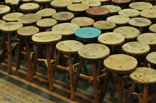 """Detail of Ai Weiwei's """"Stools"""" (2013), wooden stools"""
