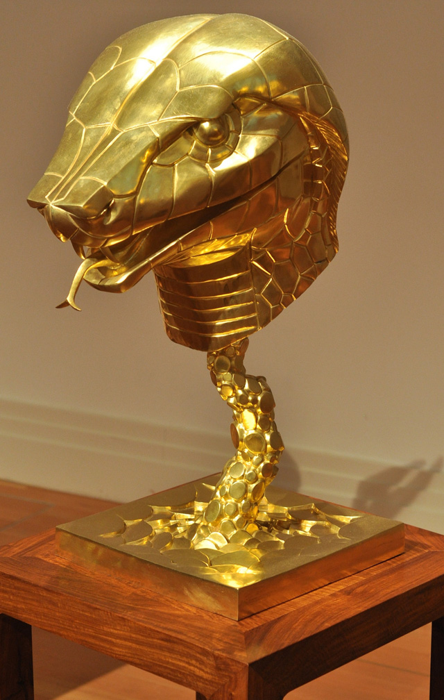 """The snake in Ai Weiwei's """"Circle of Animals"""" (2011), 12 bronze statues with gold plating"""