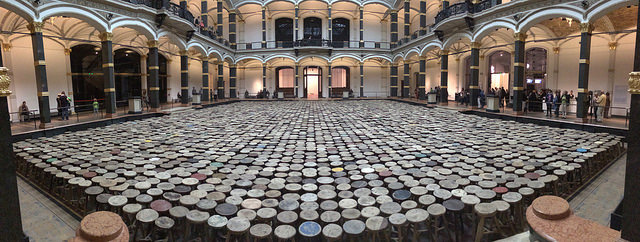 """A view of the atrium of the Martin-Gropius-Bau with Ai Weiwei's """"Stools"""" (2013), wooden stools"""