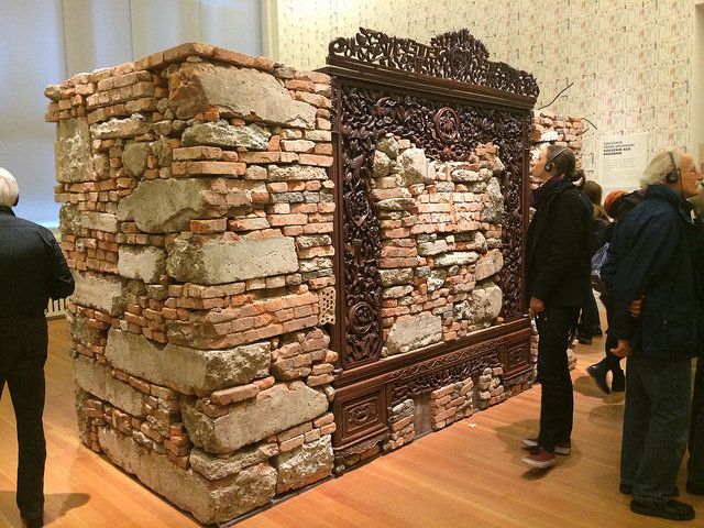 """Ai Weiwei, """"Souvenir from Shanghai"""" (2012), concrete and brick rubble from Ai Weiwei's destroyed Shanghai studio, rosewood bedframe from Qing Dynasty (1644–1911)"""
