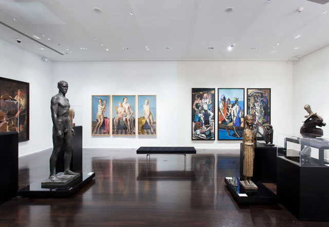 """Installation view, 'Degenerate Art: The Attack on Modern Art in Nazi Germany, 1937' at Neue Galerie, with Adolph Ziegler's """"The Four Elements"""" on wall at left Max Beckmann's """"Departure"""" on wall at right"""