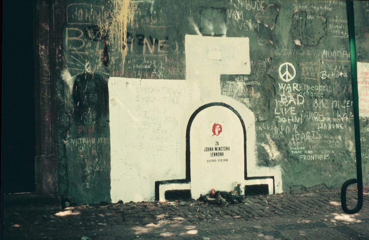 The John Lennon Wall circa 1983 (photo by David Sedlecký via Wikimedia Commons)