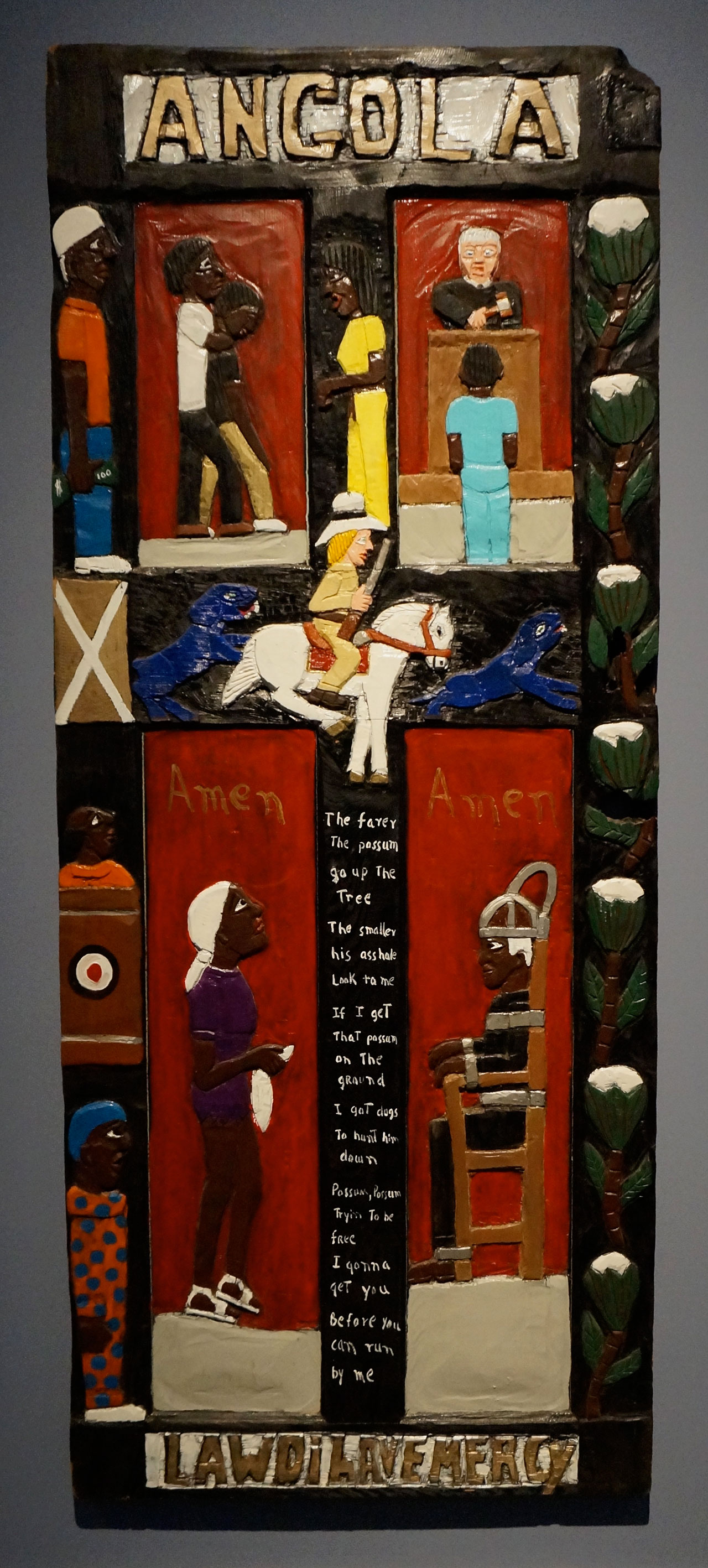 """Herbert Singleton, """"Angola"""" (nd [1990s]), painted wood bas relief, collection of Gordon W. Bailey, Los Angeles (click to enlarge)"""
