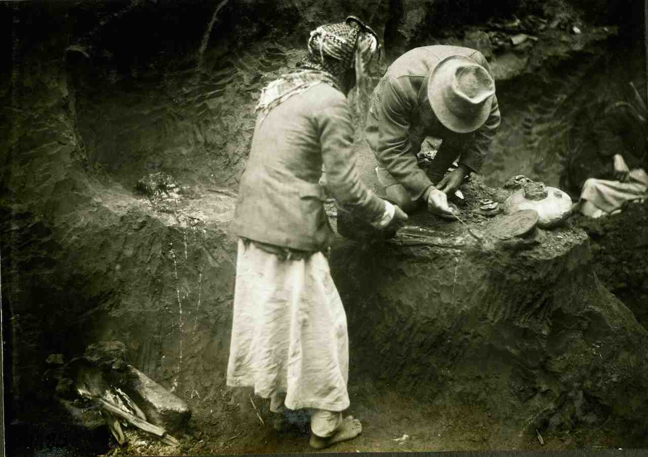 Leonard Woolley waxing a skeleton for removal (courtesy Institute for the Study of the Ancient World)