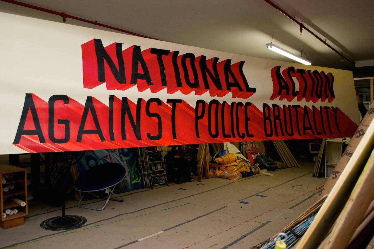 Banner for O22 Nat day against police brutality (photo courtesy People's Climate Arts)