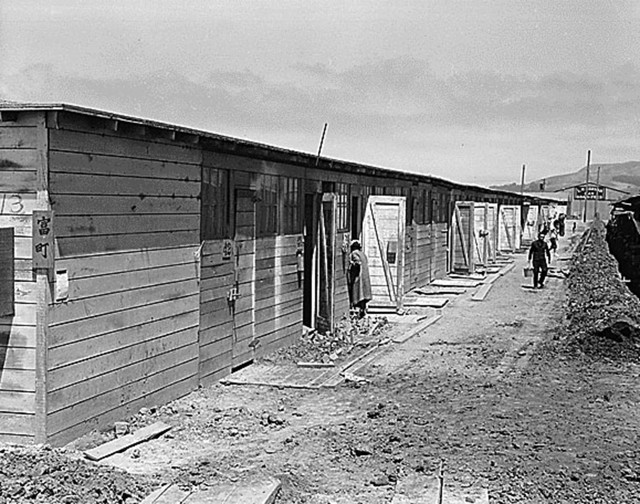 San Bruno, CA, June 16, 1942. Barracks at Tanforan Assembly Center, the site of a former racetrack. The camp had been open for about six weeks (Photographed by Dorothea Lange, WRA / Courtesy of the National Archives and Records Administration via Densho.org (National Archives Identifier 537919))