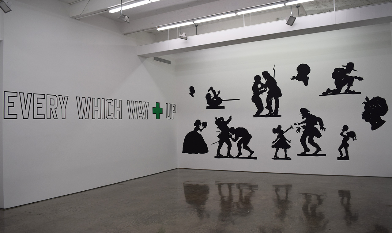 """Lawrence Weiner, """"LANGUAGE + THE MATERIAL REFERRED TO"""" (2010, left), Kara Walker, """"Auntie Walker's Wall Sampler for Civilians"""" (2013, right)"""