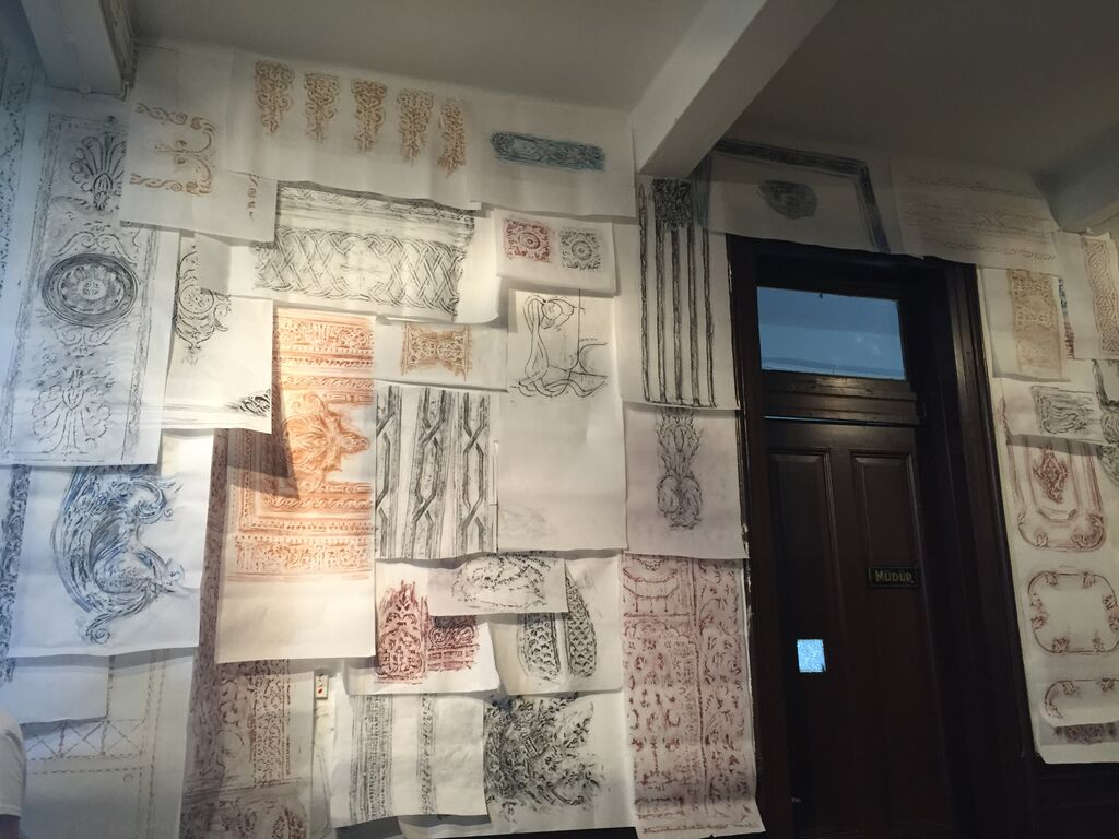 """Detail of architectural rubbings in Michael Rakowitz's """"The Flesh is Yours, The Bones are Ours"""" at Galata Greek Primary School"""