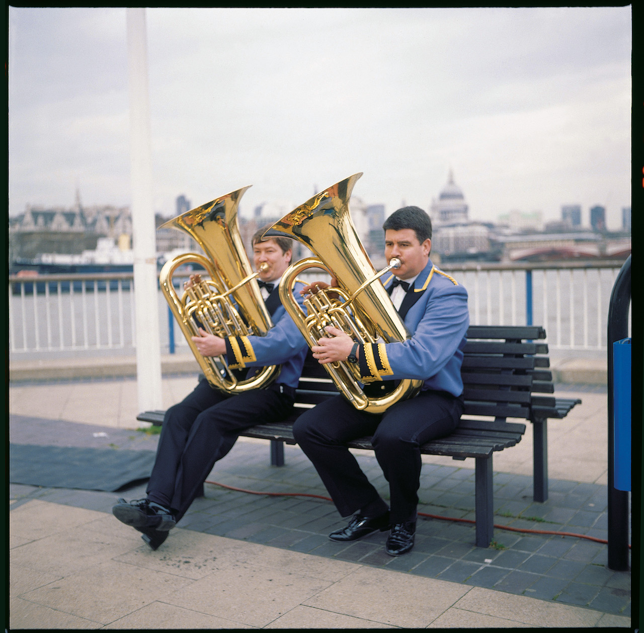 """Jeremy Deller, """"Acid Brass"""" (1997). Band members warming up on the Southbank, London, before appearing on 'The Richard and Judy Show.' (photo by Jeremy Deller)"""