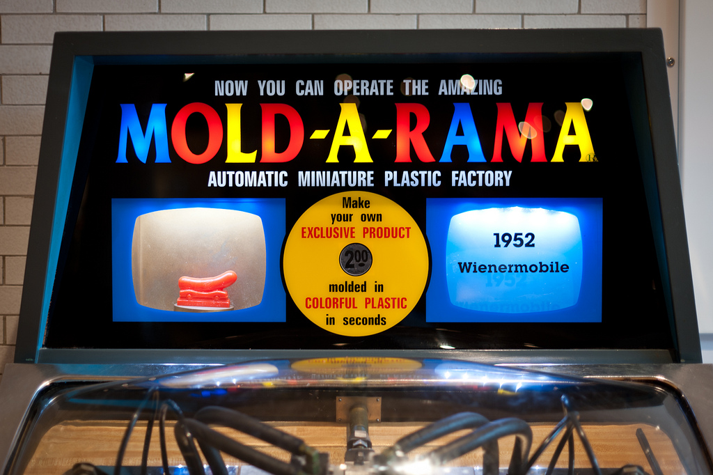 A Mold-A-Rama machine with a Wienermobile in the Henry Ford Museum in Michigan (photo by randychiu/Flickr)