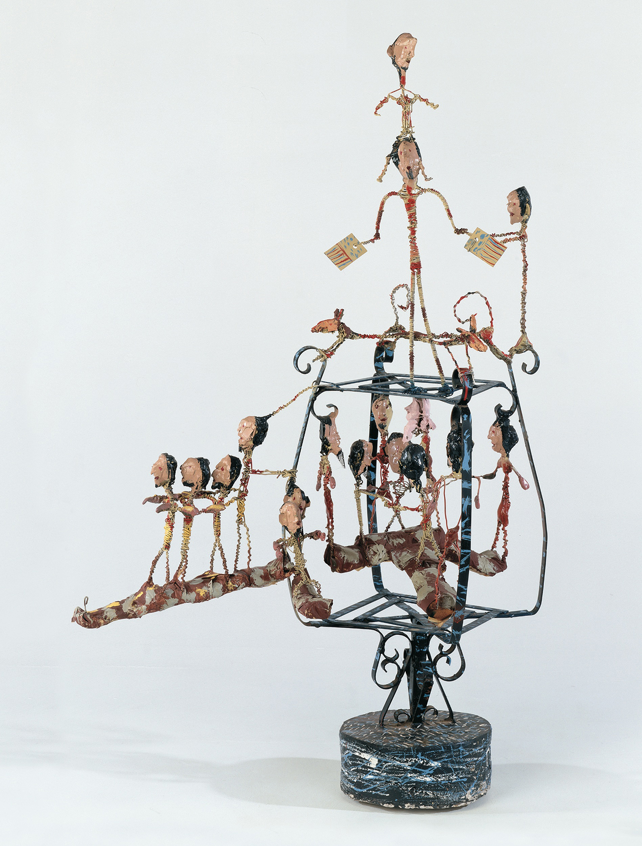 """Thornton Dial, """"Freedom Marchers"""" (1987), wire, steel, tape, wire screen, packing foam, concrete, enamel, and Splash Zone compound, 25.5 x 37.25 x 25.5 inches (photo by Stephen Pitkin/Pitkin Studio, courtesy Souls Grown Deep Foundation) (click to enlarge)"""