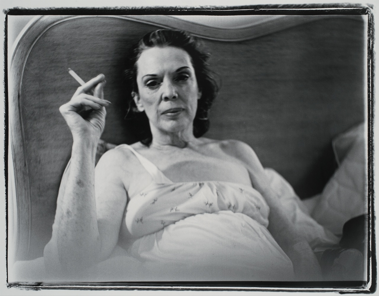 """Marilyn Minter, """"Coral Ridge Towers (Mom Smoking)"""" (1969), gelatin silver print, sheet 16 by 20 in. (collection of Beth Rudin DeWoody)"""