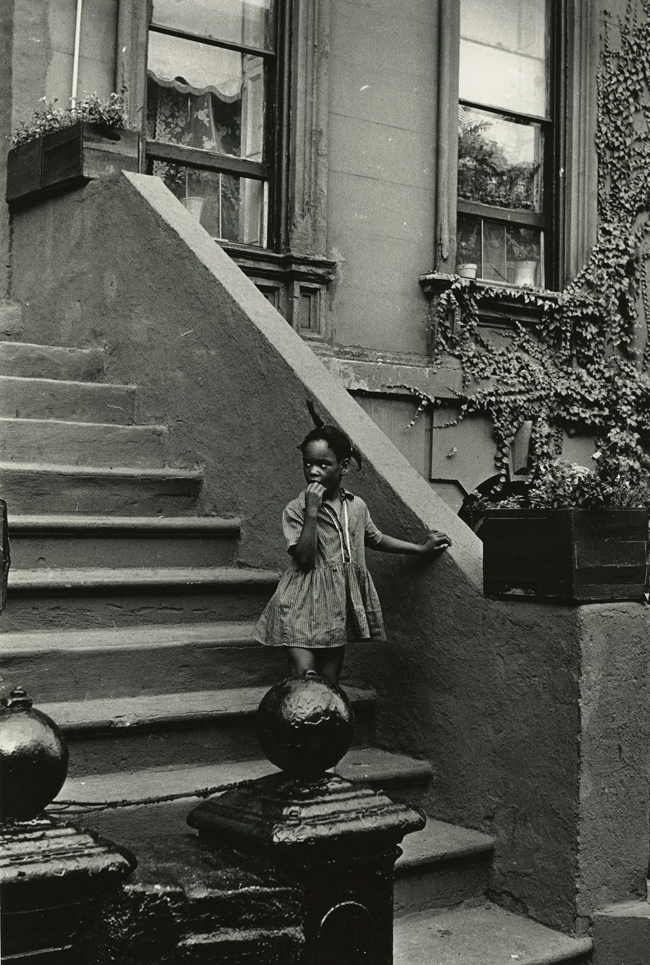 """Louis Draper, """"Untitled (Girl on steps, building with ivy)"""" (c. 1965), vintage gelatin silver print, printed c. 1965 14 x 11 inches"""