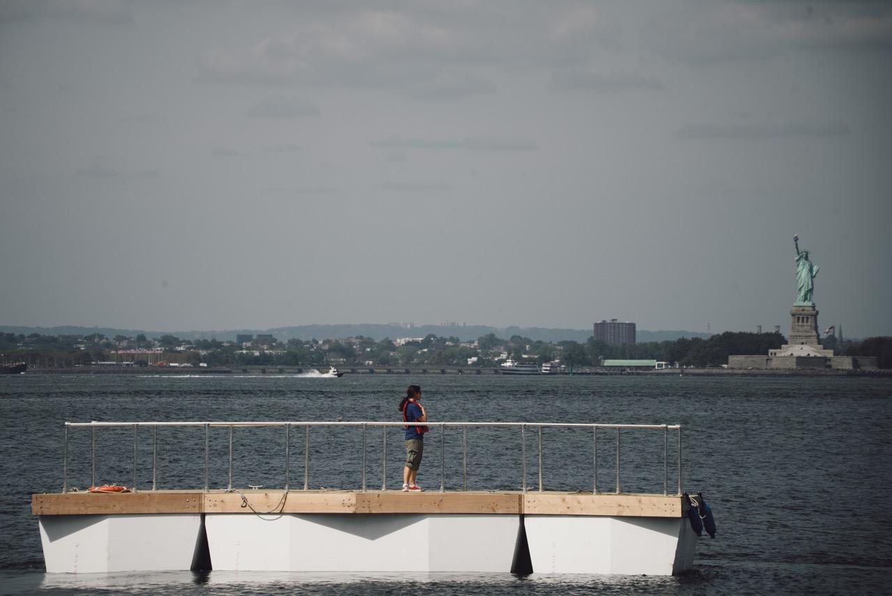 """Nancy Nowacek standing on the """"Citizen Bridge"""" """"Superblock Prototype"""" in Gowanus Bay"""