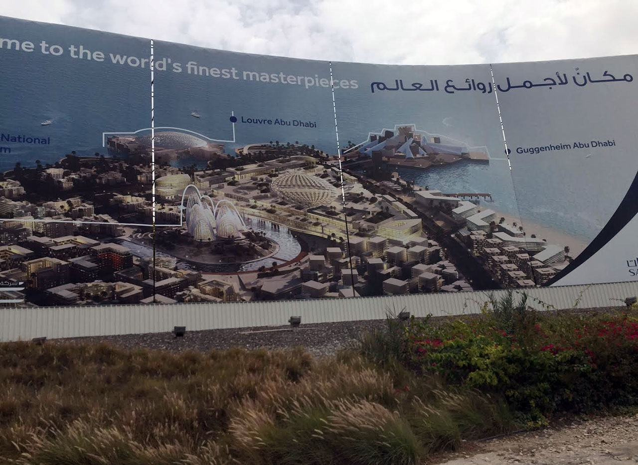 A billboard on Saadiyat Island, Abu Dhabi, advertises several of the museum projects as The World's Finest Masterpieces, including the Guggenheim Abu Dhabi on the top right. (photo by the author for Hyperallergic)