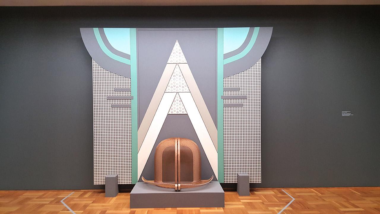 "Diane Simpson, ""Window Dressing: Background 2, Bowler"" (1994/2007), foam board, wood, steel, enamel, fabric, medium density fiberboard, and rayon, silk cord (click to enlarge)"