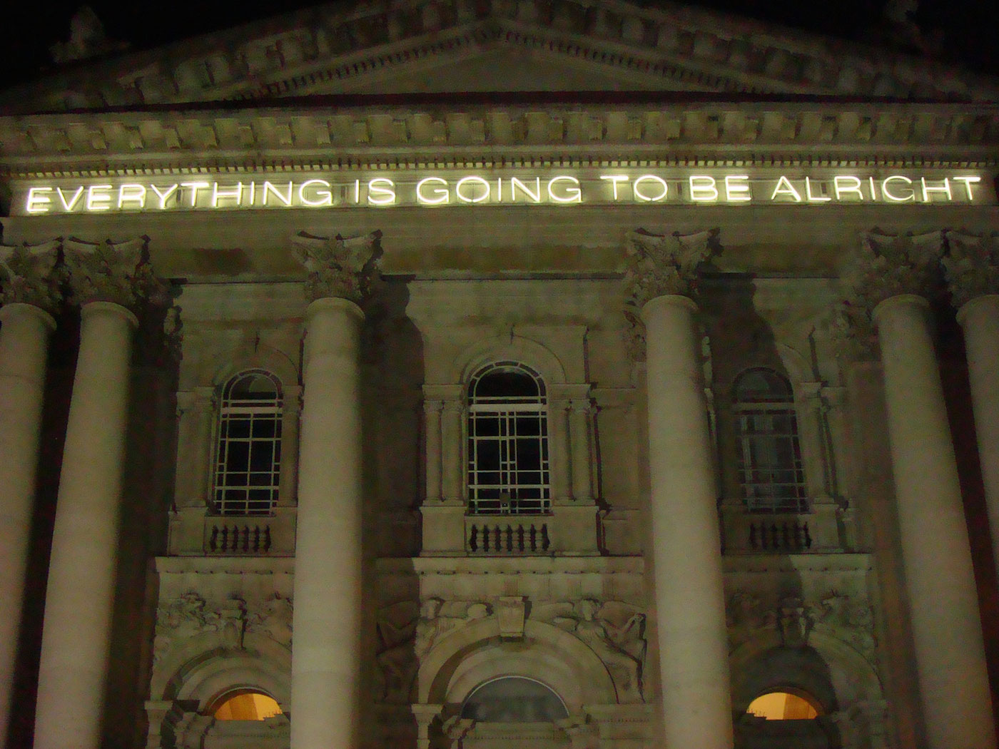 """Martin Creed, """"Work No.203: EVERYTHING IS GOING TO BE ALRIGHT"""" (1999) on the façade of Tate Britain (photo by Steve Wilde/Flickr)"""