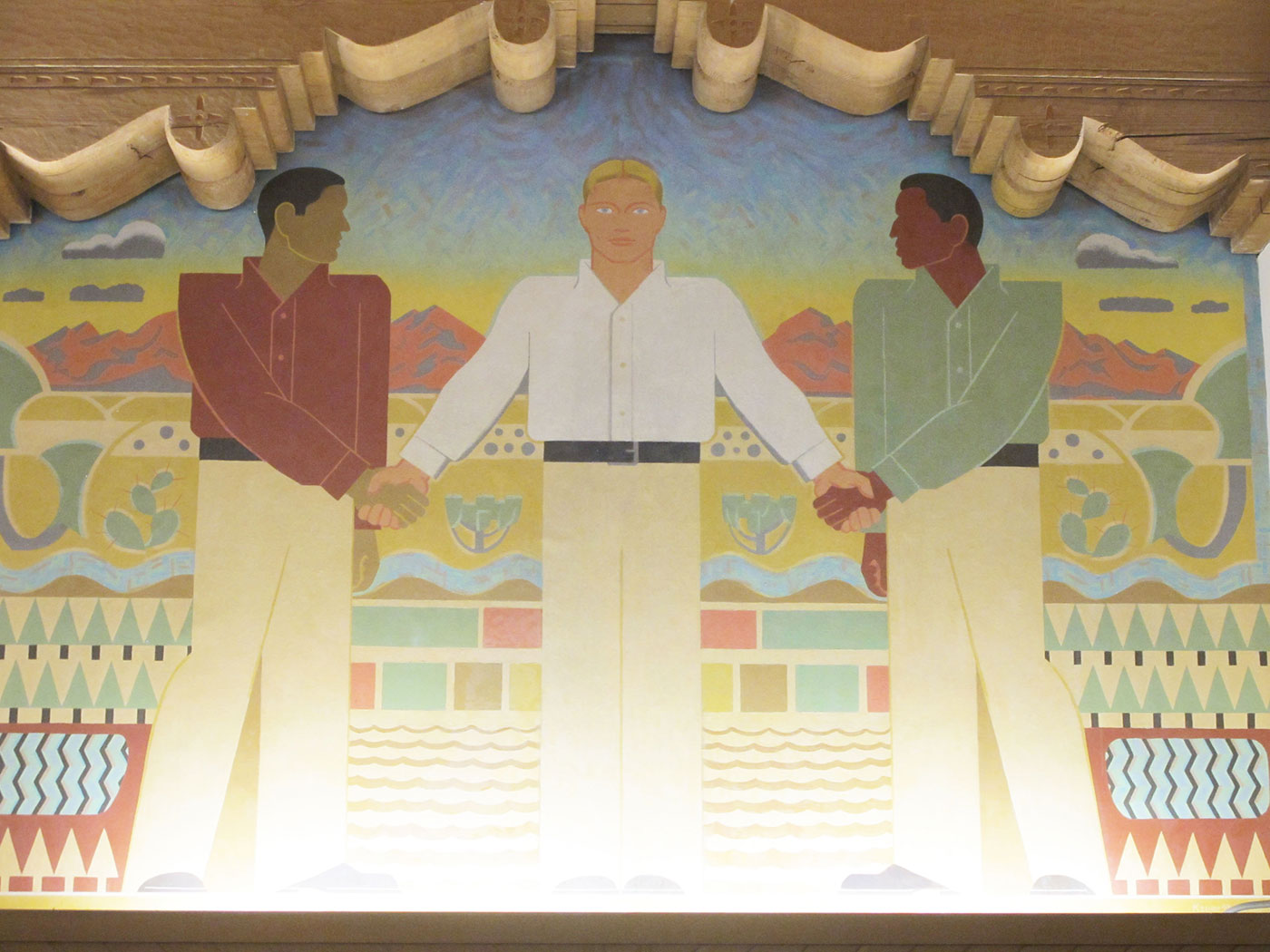 The final mural, which suggests that white people brought peace and cooperation to the region by civilizing it
