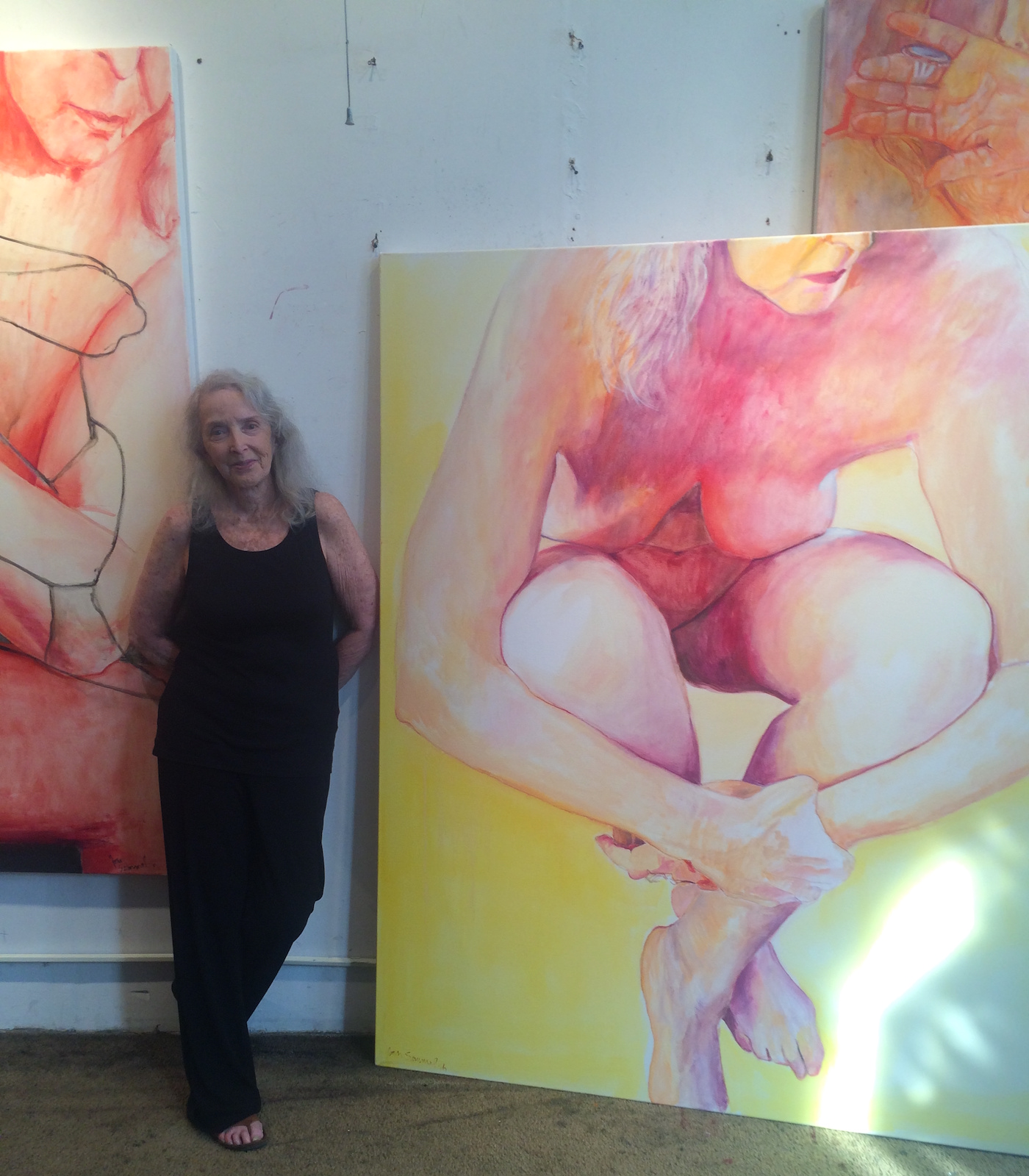 """Joan Semmel in her studio alongside """"Embrace"""" (2016) (photo by the author for Hyperallergic)"""