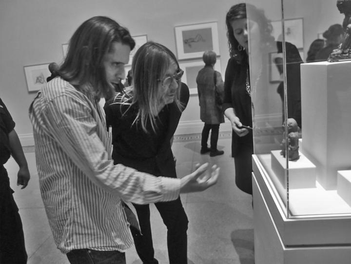 Jeremy Deller explains an ancient statue to Iggy Pop