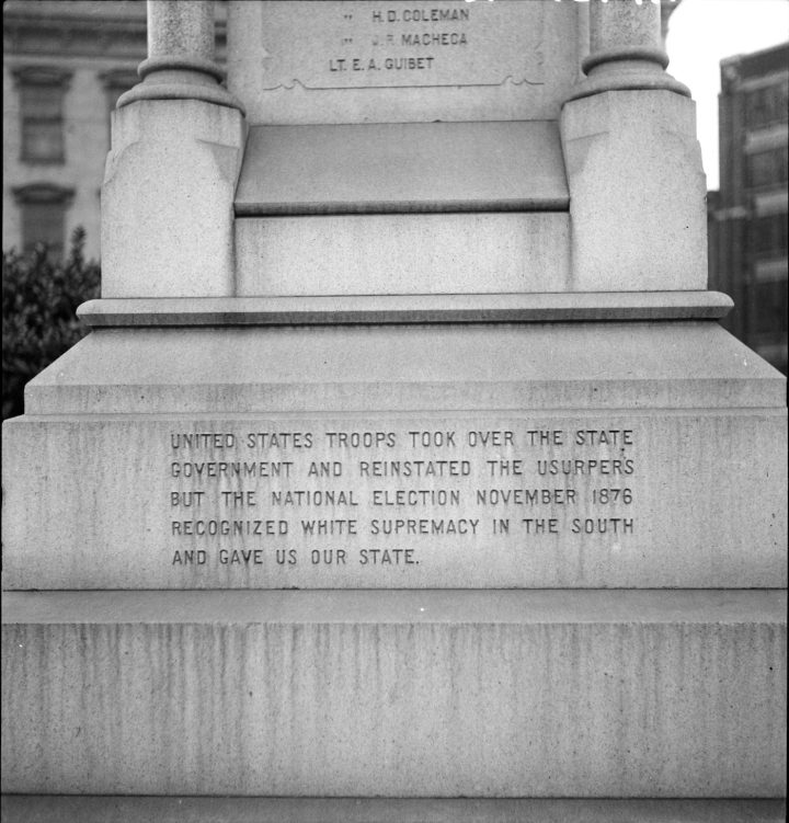 """Dorothea Lange, """"One side of the monument erected to race prejudice. New Orleans, Louisiana"""" (1936) (via Wikimedia Commons)"""