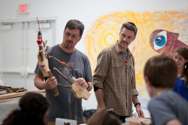 Matt Dehaemers and Mark Cowardin lead a demonstration with the M'Assim Tovim youth group during a repurposed wood and brush art-making workshop. (image Courtesy of the Epsten Gallery, Overland Park, KS)
