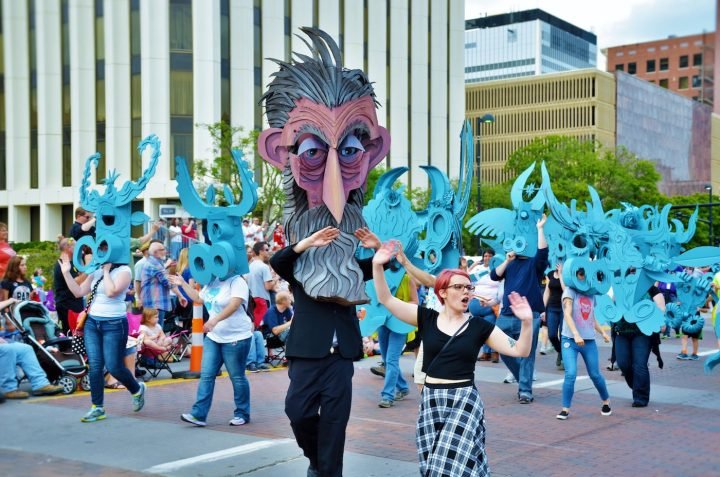 Inaugural Riverfest artist-in-residence Wayne White shows off large-scale puppets made in collaboration with local artists at the festival's Sundown parade (photo courtesy of Wichita Festivals, Inc., Wichita, KS)