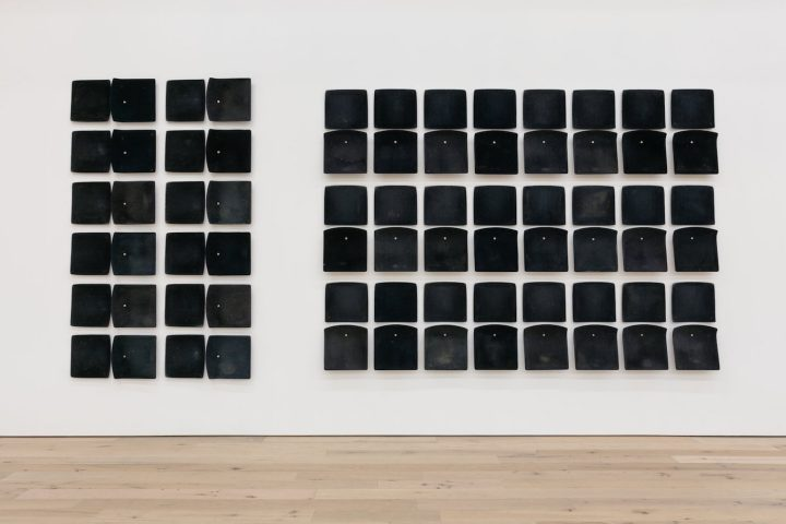 """Jessica Vaughn, """"After Willis (rubbed, used and moved) #005"""" (2017), 36 individual pairs of used machine fabricated public transit train seats (Chicago Transit Authority 1998–2011), 98 x 225 x 1/4 in"""