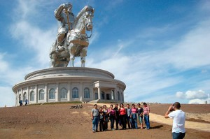 Tourists pose for photos in front of a new, 40-meter-high statue of Genghis Khan about 50 kilometers from the Mongolian capital Ulaanbaatar. (Photo by Joshua Kucera)