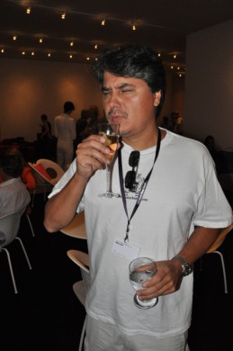 Celso partaking in the free champagne at Art Basel Miami's press preview