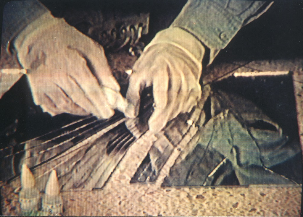 A still from Zhang Peili's 30x30. Latex gloves feature prominently in much of his work. Image courtesy Minsheng Art Museum.