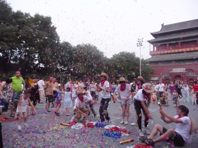 """Both locals and expats enjoyed the """"fireworks"""" beneath the historic Drum Tower in Beijing. Photo by An Xiao Mina."""
