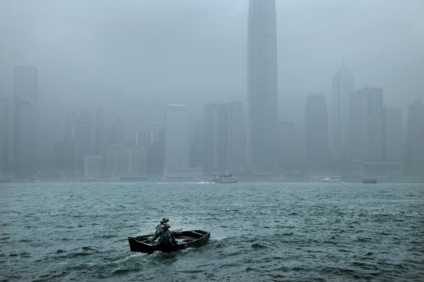 "French photographer Christophe Jacrot's ""La traversée"" captures rainy scenes in different cities."