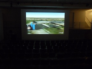 ETAK- a TomTomopera screened within a large theater space.