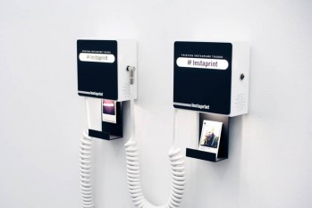 Instaprint installs on a wall and displays the hashtag or geotag you want to automatically print. Image via http://instaprint.me.