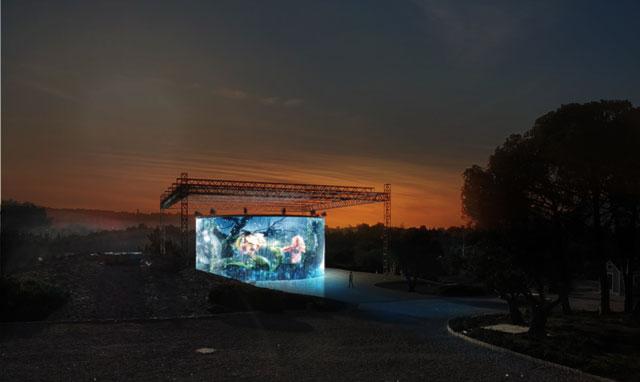 "Ron Arad's ""720 Degrees"" with Matt Collishaw's ""Sordid Earth"" projected onto it"