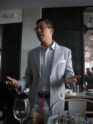 Artlantic curator Lance Fung speaking at the Miami press lunch