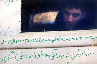 "A photo from Enri Canaj's ""Trapped"" series (click to enlarge) (image via enricanaj.com)"