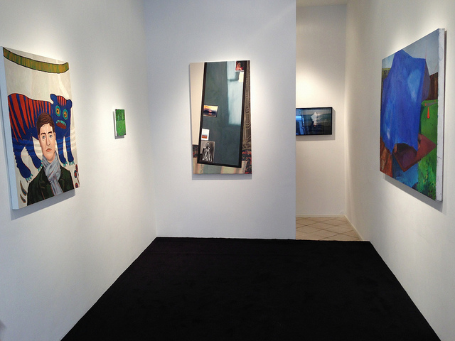 """View of Storefront's """"fiction/non-fiction"""" show with Holly Coulis' """"Tiger Death"""" (2012) on left and Michelle Hailey's """"From the West"""" (2013)."""