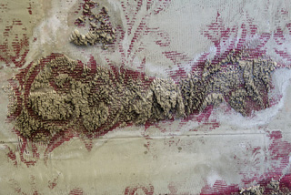 """Naomi Safran-Hon, """"Interior Wall I (Red)"""" (detail) (2012), cement, pigment, lace, and fabric, 62 x 64 in (click to enlarge)"""