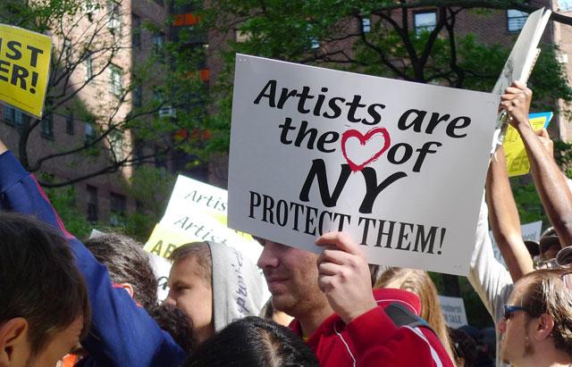 A scene from a 2010 protest in New York City. (photo by Karin Maraney, via agoraartgalleryblog.com)