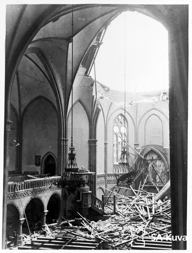 A church with a bombed out roof.