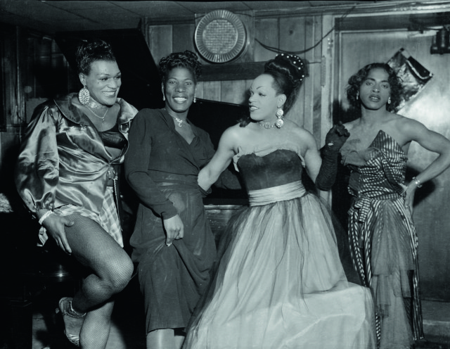 Charles ' Teenie' Harris, Group portrait of four cross-dressers posing in a club or a bar in front of a piano, including Michael 'Bronze Adonis' Fields, on left, and possibly 'Beulah' on right, 1955, black and white photograph (Collection: Carnegie Museum of Art, Pittsburgh)